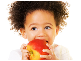 Image of a young girl eating an apple